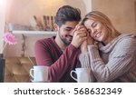 beautiful young couple sitting... | Shutterstock . vector #568632349
