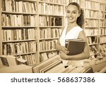 young  positive woman buying... | Shutterstock . vector #568637386