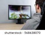 man watching  on tv  tornado | Shutterstock . vector #568638070