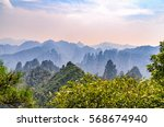 mountains covered with fog at... | Shutterstock . vector #568674940