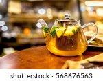 teapot of herbal tea with... | Shutterstock . vector #568676563