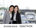two asian woman stick closely... | Shutterstock . vector #568679458