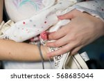 mother holding premature baby... | Shutterstock . vector #568685044
