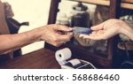 people hands credit card... | Shutterstock . vector #568686460