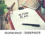 action plan text on notebook... | Shutterstock . vector #568694659