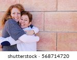 portrait of two smiling 40... | Shutterstock . vector #568714720