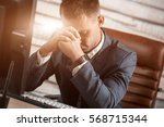tired business man at workplace ... | Shutterstock . vector #568715344