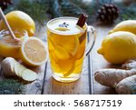 Cup of green natural tea with ginger, lemon and honey on wooden vintage background. Healthy drink. Hot winter beverage concept.
