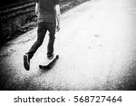 skateboarding on asphalt road... | Shutterstock . vector #568727464