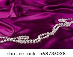 Pearl Necklace On Curvy Crimso...