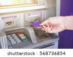 hand inserting atm card into... | Shutterstock . vector #568736854
