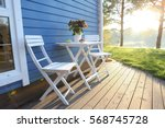 summer terrace  table and chairs | Shutterstock . vector #568745728