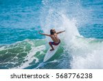 riding the waves. hermosa beach ... | Shutterstock . vector #568776238