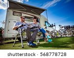 couple on holiday at a campsite.... | Shutterstock . vector #568778728