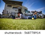 woman on the grass  looking at... | Shutterstock . vector #568778914