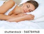 beautiful young woman lying in...   Shutterstock . vector #568784968