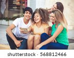 group of teenagers on the... | Shutterstock . vector #568812466