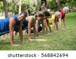 fitness class practicing yoga...   Shutterstock . vector #568842694