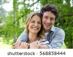 smiling couple embracing in
