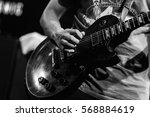 the guitarist is playing guitar ... | Shutterstock . vector #568884619