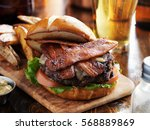 bacon burger with pretzel bun...   Shutterstock . vector #568889869