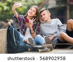 teenagers taking picture of... | Shutterstock . vector #568902958