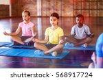school kids meditating during... | Shutterstock . vector #568917724