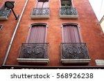 vintage rustic windows on red... | Shutterstock . vector #568926238