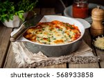 baked stuffed conchiglioni with ... | Shutterstock . vector #568933858