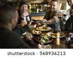 diverse people enjoy food... | Shutterstock . vector #568936213