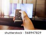 Hand Holding Use Remote Contro...