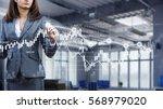 businesswoman draw diagrams .... | Shutterstock . vector #568979020
