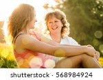 mother and her teenage daughter ... | Shutterstock . vector #568984924