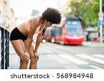 tired woman runner taking a... | Shutterstock . vector #568984948
