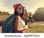 young beauty hiker walking... | Shutterstock . vector #568997014