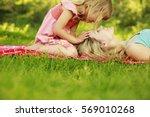 happy mother with baby in... | Shutterstock . vector #569010268