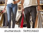 couple with shopping bags | Shutterstock . vector #569014663