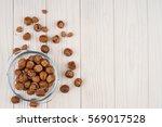 hazelnut in a glass bowl on the ...   Shutterstock . vector #569017528