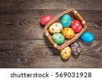 easter eggs in basket of wooden ... | Shutterstock . vector #569031928