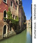small canal of venice  italy | Shutterstock . vector #569044018