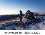 man tourist on mountain top | Shutterstock . vector #569063218