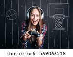overjoyed delighted woman... | Shutterstock . vector #569066518