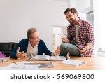 joyful happy man laughing with... | Shutterstock . vector #569069800