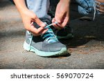 hands of a young woman lacing... | Shutterstock . vector #569070724