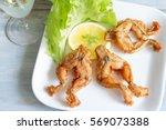 fried frog legs on plate food... | Shutterstock . vector #569073388