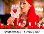 fortuneteller with tarot cards... | Shutterstock . vector #569079400