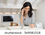 happy young woman taking notes...   Shutterstock . vector #569081518
