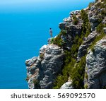standing on the cliff edge of... | Shutterstock . vector #569092570