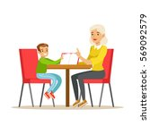 grandmother and a boy reading a ...   Shutterstock .eps vector #569092579