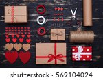 Small photo of High angle of systematized decorative stuff using to create a present box for valentine day. Wrapping papers, ribbon, scissors, labels and other things isolated over grunge flat lay background